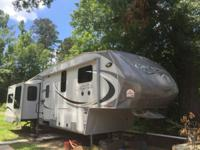 Never used 5th Wheel RV that is in excellent condition.