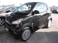 This outstanding example of a 2011 Smart fortwo Pure is