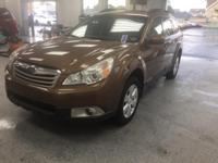 This 2011 Subaru Outback 2.5i in caramel bronze