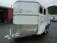THIS 2011 THURO-BILT WRANGLER PREMIER 2-HORSE SLANT