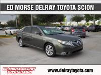 This outstanding example of a 2011 Toyota Avalon