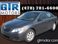This Camry rides and drives great. Good on gas. Call