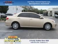 This 2011 Toyota Corolla S in Sandy Beach Metallic is