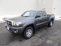 You are looking at a 2011, Charcoal Gray, Toyota Tacoma