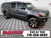 Own the off-road in this 2011 Toyota Tacoma Double Cab