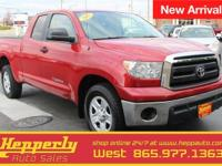 This 2011 Toyota Tundra Grade in Radiant Red features.
