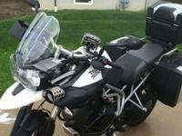 ,.,,,2011 Triumph Tiger XC with many ad-ons. It has