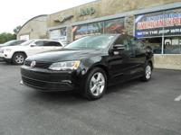 Climb inside the 2011 Volkswagen Jetta! Simply a great