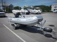 Like new, 2011 West Marine 11' Rigid Hull Inflatable