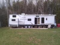 2011 Wildwood 408 loft Grand lodge. Set up as a