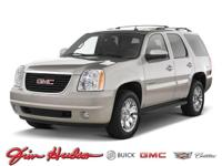 This 2011 GMC Yukon AWD 4dr 1500 Denali is offered to