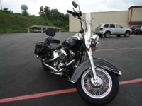 The Harley FLSTC has full length rider footboards with
