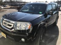 You can find this 2011 Honda Pilot Touring and many