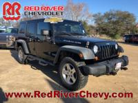 This 2011 Jeep Wrangler Unlimited Rubicon delivers both