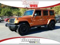 Orange 2011 Jeep Wrangler Unlimited Sahara 4WD 3.8L V6