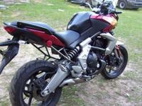 2011 KAWASAKI VERSYS, THIS BIKE IS A ONE OWNER BIKE. IT