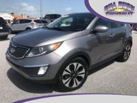 This 2011 Kia Sportage SX in Mineral Silver features a