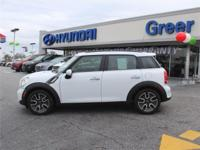 This 2011 MINI Base 4dr Front-wheel Drive Sports