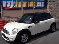This 2011 MINI Cooper Hardtop 2dr Hatchback showcases a
