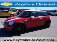 This exceptional instance of a 2011 MINI Cooper Hardtop