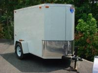 5 x 8 Cargo Color is White Trailer has a V-nose, Rear