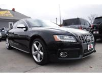 Leather heated seats, navigation w/backup camera, and