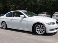 This 2012 BMW 3 Series 328i in White Metallic features: