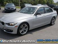 BMW 328i Sedan in Silver over Black with Sport Line.