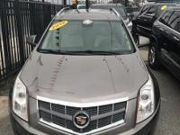 Drive away with this beautiful 2012 Cadillac SRX. Down