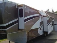 This is a 2012 cedar creek custom. It has 3 slides,