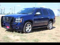 This BLUE 2012 Chevrolet Tahoe LTZ might be just the