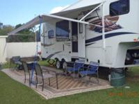 2012 Chaparral lite 1/2 ton towable, Rear kitchen,