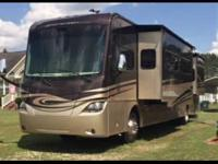 This 2012 Coachmen Cross Country is powered by a