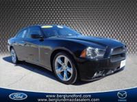 2012 Dodge Charger R/T hemi V-8 car on black that looks