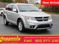 This 2012 Dodge Journey SXT in Bright Silver Metallic