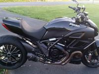 ,,,,2012 Ducati Diavel with 6,000 miles and many