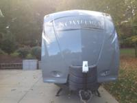 This is a 2014 Dutchmen Komfort 34' travel trailer that