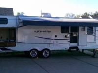 2012 Wildcat bunkhouse pull behind travel trailer. This