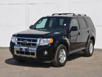 This 2012 Ford Escape Limited is proudly offered by