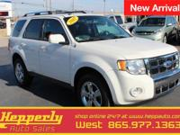 This 2012 Ford Escape Limited in Oxford White features.