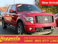 This 2012 Ford F-150 FX4 in Red Candy Metallic Tinted