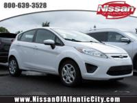 Come see this 2012 Ford Fiesta SE. Its Manual
