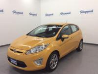 Yellow Blaze Metallic exterior, SES trim. EPA 39 MPG