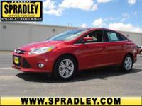 This 4dr Car is hot! This Ford Focus gets 28 miles per