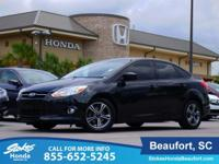 2012 Ford Focus in Black. Welcome to Stokes Honda! No