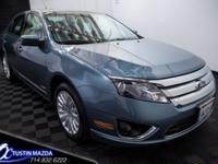 Extra clean 2012 Ford Fusion Hybrid is nicely equipped