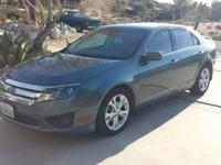 2012 Ford Fusion in good running condition. Gets