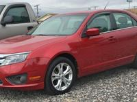 SE trim, Red Candy Metallic Tinted exterior. EPA 33 MPG