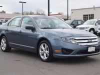This 2012 Ford Fusion SE comes with Black cloth