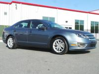Boasts 33 Highway MPG and 23 City MPG! This Ford Fusion